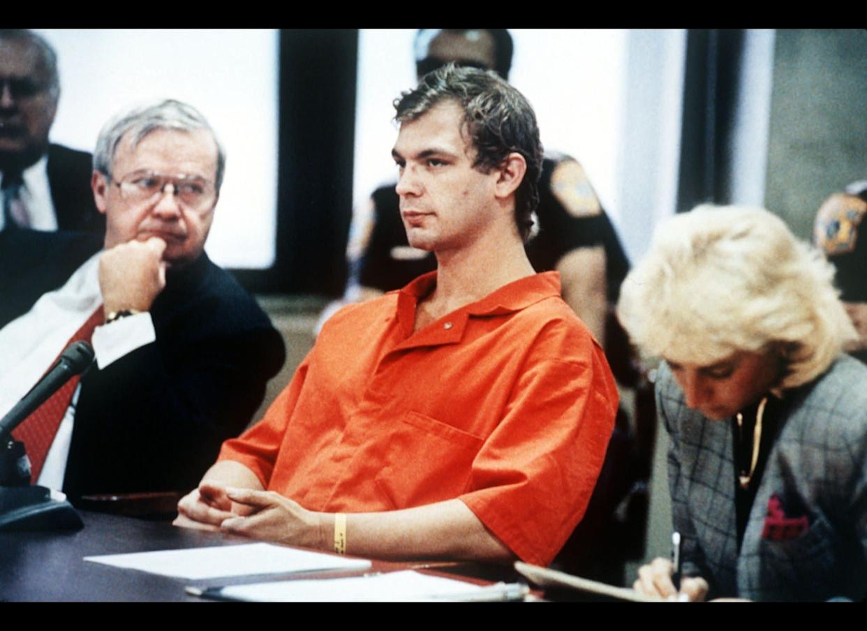 Notorious cannibal Jeffrey Dahmer sits with his defense team during his 1991 trial. Dahmer went on a killing spree in the 1980s during which he murdered 17 men and boys. He often had sex with the corpses before dismembering them and, in some cases, ate pieces of human flesh. After his conviction, Dahmer was killed by a fellow inmate in prison.
