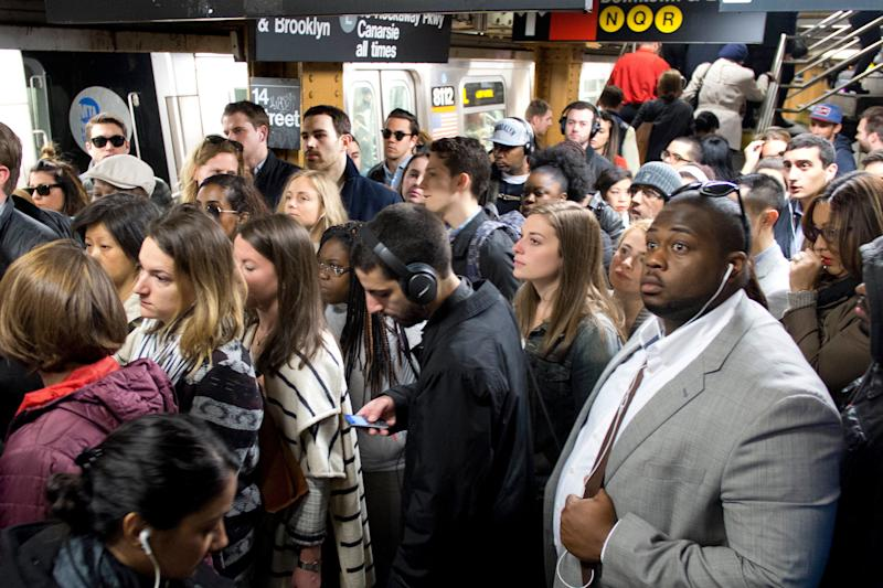 In this May 16, 2016 photo, commuters crowd a platform after exiting the L train in the Union Square subway station in New York. (AP Photo/Mark Lennihan)