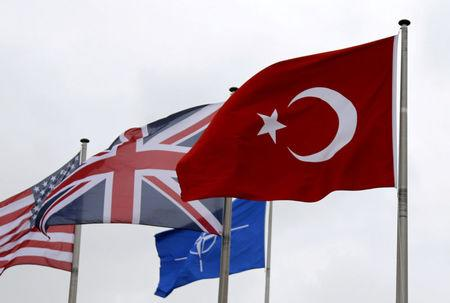 FILE PHOTO: A Turkish flag flies among others flags of NATO members during the North Atlantic Council at the Alliance headquarters in Brussels