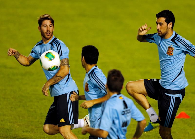 From left Spain's Sergio Ramos, Pedro Rodriguez, Jordi Alba and Sergio Busquets warm up during a training session at the soccer Confederations Cup in Fortaleza, Brazil, Monday, June 24, 2013. Spain will face Italy at Confederations Cup semifinals Thursday. (AP Photo/Fernando Llano)
