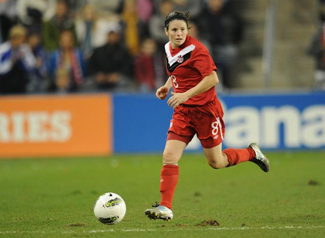 KANSAS CITY, KS - SEPTEMBER 17: Mid-fielder Diana Matheson #8 of Canada brings the ball up field against the United States during the second half on September 17, 2011 at LiveStrong Sporting Park in Kansas City, Kansas. (Photo by Peter Aiken/Getty Images)