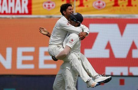 Cricket - India v Australia - Fourth Test cricket match - Himachal Pradesh Cricket Association Stadium, Dharamsala, India - 25/03/17 - India's Kuldeep Yadav (L) and Umesh Yadav celebrate the dismissal of Australia's Glenn Maxwell. REUTERS/Adnan Abidi