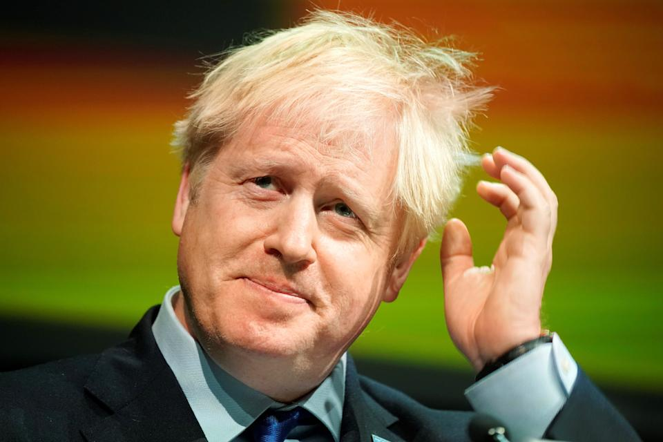 """Britain's Prime Minister Boris Johnson gestures as he delivers his speech at the Convention of the North, in the Magna Centre in Rotherham, norhtern England on September 13, 2019. - Boris Johnson will meet EU chief Jean-Claude Juncker in Luxembourg on Monday, officials said, as the British prime minister bids to broker a Brexit compromise ahead of the October 31 deadline. Preparedness in Britain for a no-deal Brexit remains """"at a low level"""", with logjams at Channel ports threatening to impact drug and food supplies, according to government assessments released this week. (Photo by Christopher Furlong / POOL / AFP)        (Photo credit should read CHRISTOPHER FURLONG/AFP/Getty Images)"""