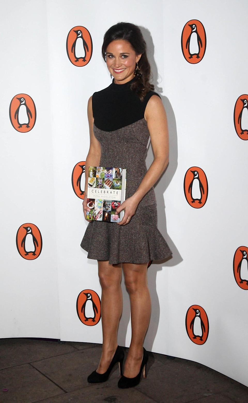 <p>Pippa opted to wear a Stella McCartney dress with a flared skirt to her book launch in 2012.<i> [Photo: PA Images]</i> </p>