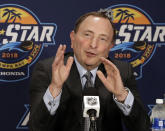 FILE - In this Jan. 27, 2018, file photo, NHL Commissioner Gary Bettman gestures during a news conference before the Skills Competition at the NHL All-Star Game events, in Tampa, Fla. The NHL is finally shrugging off its reputation as being a 'men-only club with the Maple Leafs hiring Hayley Wickenheiser to a player development role, and Kim Pegula taking over as president of the Buffalo Sabres. Calling them the best candidates for the positions regardless of gender, Commissioner Bettman stressed the importance of encouraging diversity. (AP Photo/Chris O'Meara, File)