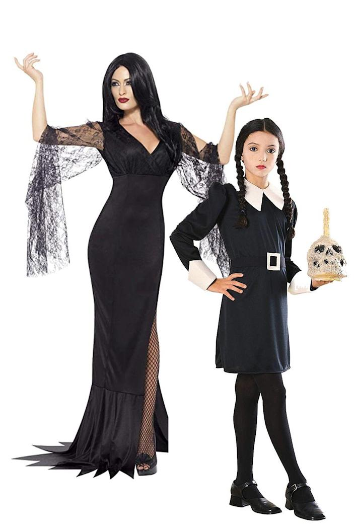 """<p>You're creepy and you're kooky, mysterious and spooky—you're Morticia and Wednesday Addams! For this one, you can buy a costume or DIY your own using items you already have.</p><p><a class=""""link rapid-noclick-resp"""" href=""""https://www.amazon.com/Smiffys-Immortal-Costume-Legends-Halloween/dp/B00TSBPM5A/?tag=syn-yahoo-20&ascsubtag=%5Bartid%7C2164.g.37079496%5Bsrc%7Cyahoo-us"""" rel=""""nofollow noopener"""" target=""""_blank"""" data-ylk=""""slk:SHOP Morticia Addams Costume"""">SHOP Morticia Addams Costume</a></p><p><a class=""""link rapid-noclick-resp"""" href=""""https://www.amazon.com/Addams-Family-Childs-Wednesday-Costume/dp/B001CTRY6Q?th=1&tag=syn-yahoo-20&ascsubtag=%5Bartid%7C2164.g.37079496%5Bsrc%7Cyahoo-us"""" rel=""""nofollow noopener"""" target=""""_blank"""" data-ylk=""""slk:SHOP Wednesday Addams Costume"""">SHOP Wednesday Addams Costume</a></p>"""