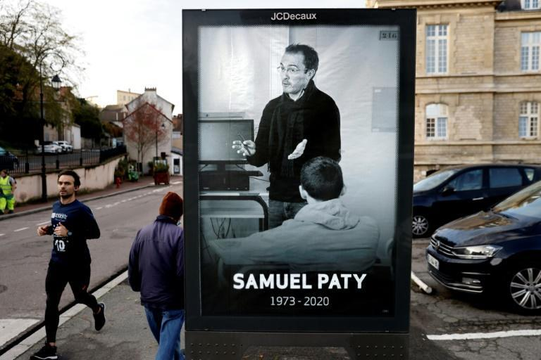 A bus stop tribute to French teacher Samuel Paty in Conflans-Sainte-Honorine, the Paris suburb where he was beheaded last month