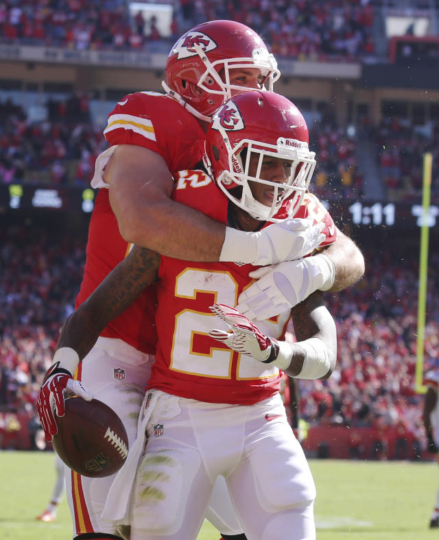 Kansas City Chiefs wide receiver Dexter McCluster (22) is congratulated by teammate Anthony Fasano following a touchdown during the first half of an NFL football game against the Cleveland Browns in Kansas City, Mo., Sunday, Oct. 27, 2013. (AP Photo/Ed Zurga)