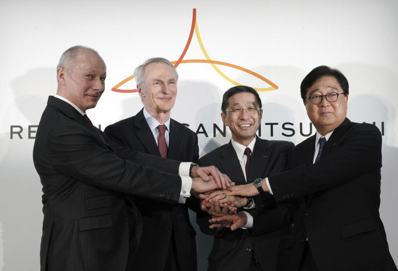 "From left, Renault CEO Thierry Bollore, Renault Chairman Jean-Dominique Senard, Nissan CEO Hiroto Saikawa and Mitsubishi Motors Chairman and CEO Osamu Masuko pose for photographers after their joint press conference at the Nissan headquarters in Yokohama, near Tokyo, Tuesday, March 12, 2019. The chief executives of Renault, Nissan and Mitsubishi announced Tuesday a new board to oversee the French-Japanese auto alliance, in an effort to drive home a message about what they called ""a new start"" for the partnership, despite the recent arrest of former chairman Carlos Ghosn. (AP Photo/Eugene Hoshiko)"