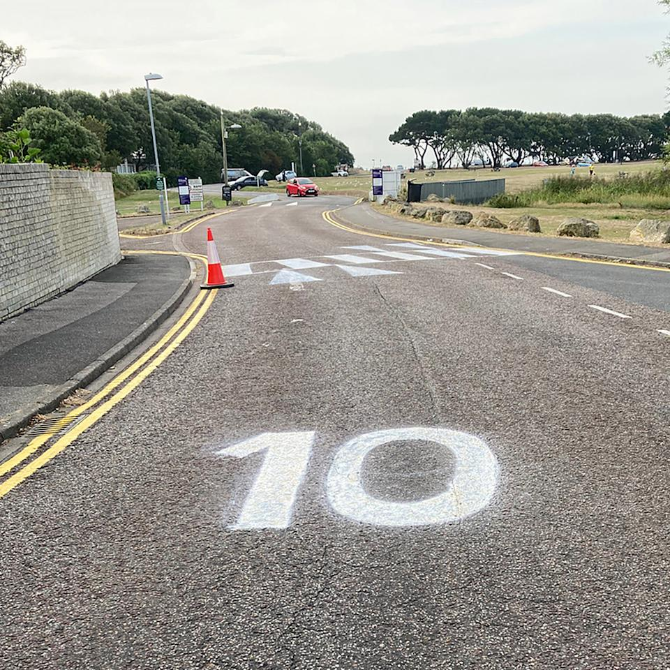A man in the UK has painted a crossing on his road to help out his disabled wife. Source: Bournemouth News/Australscope