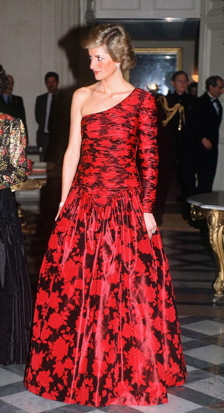<p>Diana wore a dress that was quite striking for the era: a red and black patterned one shoulder dress. The Princess wore the Catherine Walker evening gown to a dinner hosted by the British Ambassador while in Paris. </p>