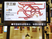 The status of the train services delayed by an earthquake are seen on a monitor at JR Tokyo station following an earthquake, in Tokyo, Thursday, Oct. 7, 2021. A powerful earthquake shook the Tokyo area on Thursday night, but officials said there was no danger of a tsunami.(Kyodo News via AP)