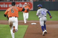 Texas Rangers' Yonny Hernandez (65) is picked off by Baltimore Orioles starting pitcher Chris Ellis and caught stealing by shortstop Pat Valaika during the second inning of a baseball game Saturday, Sept. 25, 2021, in Baltimore. (AP Photo/Terrance Williams)