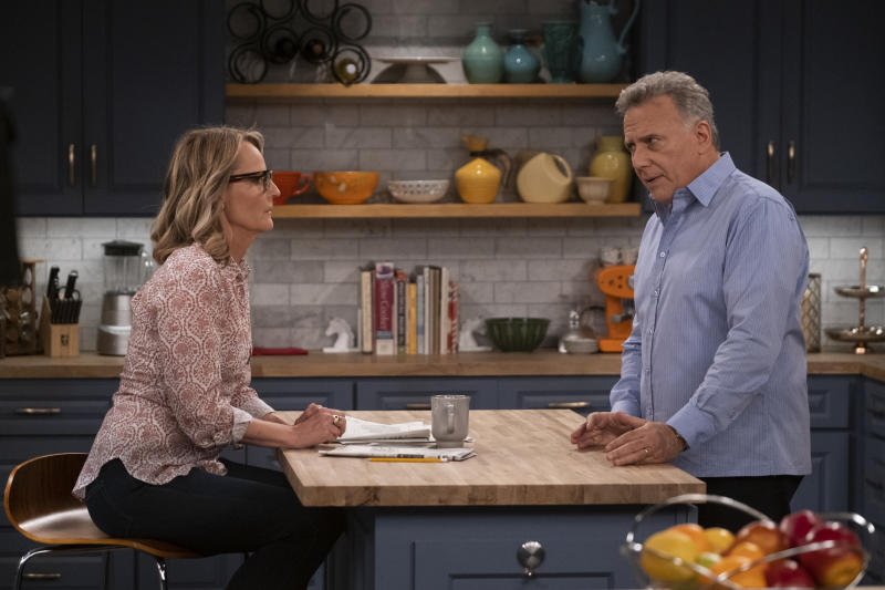 """This image released by Sony Pictures Television/Spectrum Originals shows Paul Reiser, right, and Helen Hunt in a scene from """"Mad About You,"""" a reboot of the 1990s comedy series. The limited series debuts Wednesday on Spectrum Originals for on-demand subscribers. (Darren Michaels/Sony Pictures Television/Spectrum Originals via AP)"""