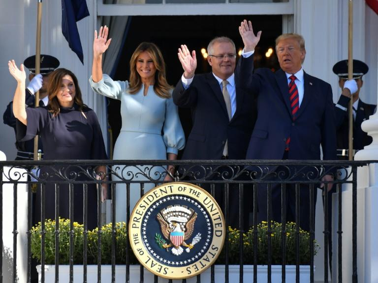 US President Donald Trump, Australian Prime Minister Scott Morrison and their wives meet for a lavish White House visit (AFP Photo/Nicholas Kamm)