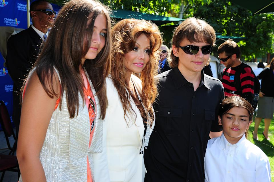 (L-R) Paris Jackson, 13,  LaToya Jackson, Prince Jackson, 14, and Blanket Jackson, 9, attend a ceremony to honor their father and brother, the late King of Pop Michael Jackson, at Children's Hospital in Los Angeles, California August 8, 2011.  Michael Jackson's three children presented the hospital with a gift of 13 pieces of original art created and signed by the late King of Pop.  AFP PHOTO / Robyn Beck (Photo credit should read ROBYN BECK/AFP via Getty Images)