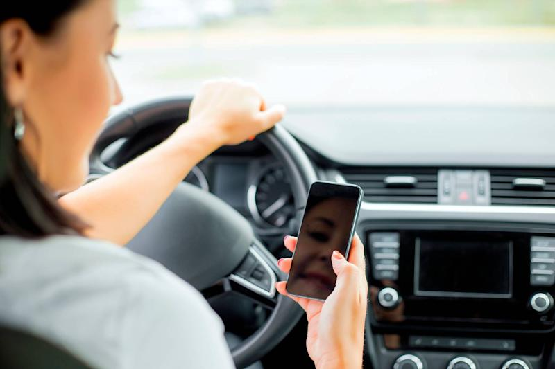 Women are less likely to be distracted while driving, research has suggested: grinvalds/iStockphoto