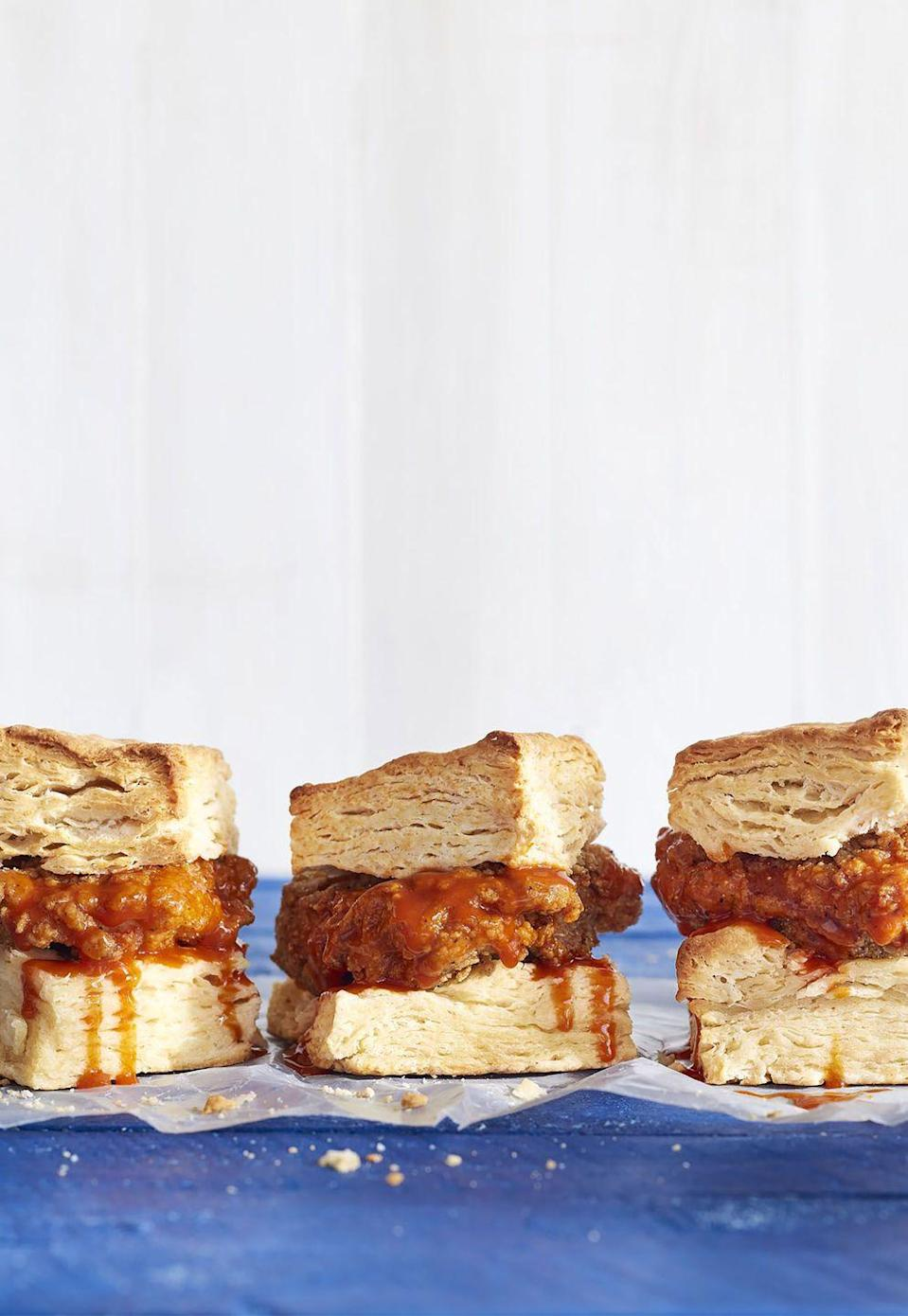 "<p>Tangy sweet and spicy chicken wedged between a buttery, flaky biscuit might just become your new staple.</p><p><strong><a href=""https://www.countryliving.com/food-drinks/recipes/a41656/mile-high-breakfast-chicken-biscuit-sandwiches-recipe/"" rel=""nofollow noopener"" target=""_blank"" data-ylk=""slk:Get the recipe."" class=""link rapid-noclick-resp"">Get the recipe.</a></strong></p>"