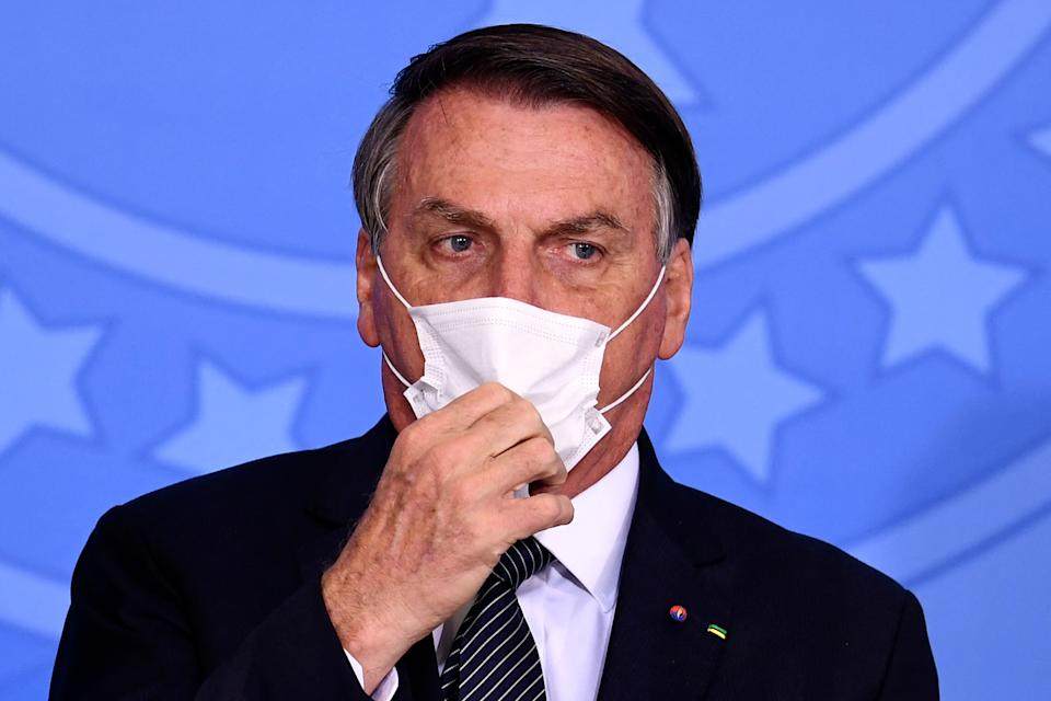 Brazilian President Jair Bolsonaro gestures during the announcement that the public healthcare system will cover expanded heel prick tests at Planalto Palace, in Brasilia, on May 26, 2021. (Photo by EVARISTO SA / AFP) (Photo by EVARISTO SA/AFP via Getty Images)