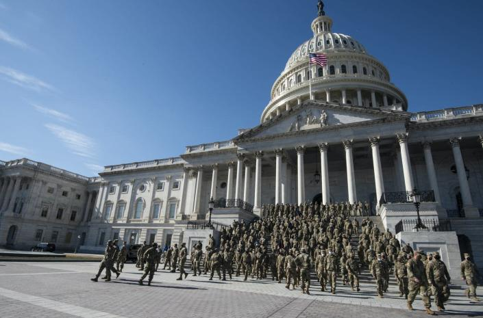 """<span class=""""caption"""">Virginia National Guard troops in front of the U.S. Capitol building, Feb. 5, 2021.</span> <span class=""""attribution""""><a class=""""link rapid-noclick-resp"""" href=""""https://www.gettyimages.com/detail/news-photo/virginia-national-guard-troops-walk-down-the-capitol-steps-news-photo/1230985766"""" rel=""""nofollow noopener"""" target=""""_blank"""" data-ylk=""""slk:Caroline Brehman/CQ-Roll Call, Inc via Getty Images"""">Caroline Brehman/CQ-Roll Call, Inc via Getty Images</a></span>"""