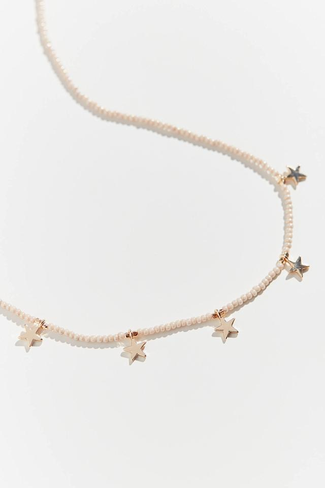"""<p>This <a href=""""https://www.popsugar.com/buy/Naomi-Beaded-Star-Necklace-524384?p_name=Naomi%20Beaded%20Star%20Necklace&retailer=urbanoutfitters.com&pid=524384&price=18&evar1=fab%3Aus&evar9=44236083&evar98=https%3A%2F%2Fwww.popsugar.com%2Ffashion%2Fphoto-gallery%2F44236083%2Fimage%2F46954187%2FNaomi-Beaded-Star-Necklace&list1=shopping%2Choliday%2Cstocking%20stuffers%2Cgift%20guide%2Cvalentines%20day%2Cfashion%20gifts%2Cgifts%20for%20women%2Cgifts%20under%20%24100%2Cgifts%20under%20%2450%2Cgifts%20under%20%2475&prop13=mobile&pdata=1"""" rel=""""nofollow"""" data-shoppable-link=""""1"""" target=""""_blank"""" class=""""ga-track"""" data-ga-category=""""Related"""" data-ga-label=""""https://www.urbanoutfitters.com/shop/naomi-beaded-star-necklace?category=gift-ideas-for-women&amp;color=014&amp;type=REGULAR"""" data-ga-action=""""In-Line Links"""">Naomi Beaded Star Necklace</a> ($18) comes in a few different finishes.</p>"""