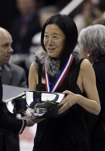FILE - This Jan. 23, 2009 file photo shows fashion designer Vera Wang holding her engraved silver bowl after being inducted into the United States Figure Skating Hall of Fame at the U.S. Figure Skating Championships in Cleveland. Wang, 63, was honored for her lifetime achievement by the Council of Fashion Designers at its star-studded awards show Monday night. She received the award from her former employer and mentor Ralph Lauren, and she received a standing ovation from her peers. (AP Photo/Amy Sancetta,File)