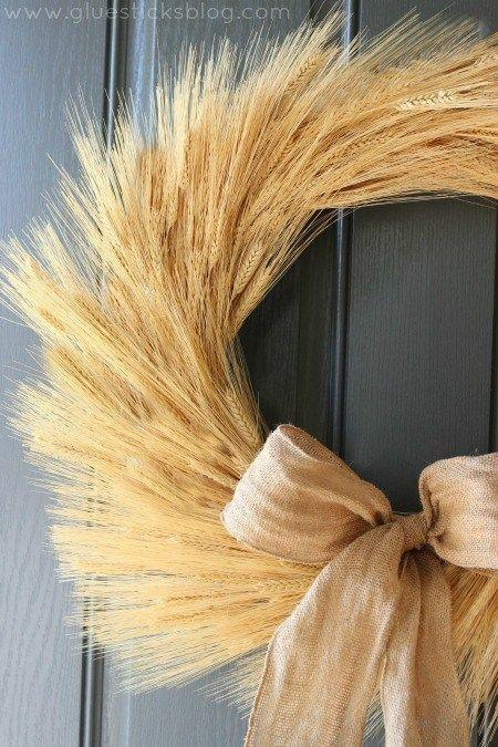 """<p>Inspired by the fall harvest, this simple straw and wheat wreath makes for a striking addition to any front door. A burlap ribbon accent keeps things feeling whimsical.</p><p><strong>Get the tutorial at <a href=""""https://gluesticksblog.com/harvest-wheat-wreath/"""" rel=""""nofollow noopener"""" target=""""_blank"""" data-ylk=""""slk:Glue Sticks Blog"""" class=""""link rapid-noclick-resp"""">Glue Sticks Blog</a>.</strong> </p>"""