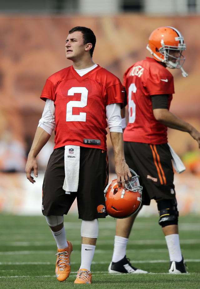 Cleveland Browns quarterback Johnny Manziel (2) waits his turn during passing drills at the NFL football training camp in Berea, Ohio, Sunday, July 27, 2014. (AP Photo/Mark Duncan)