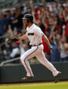 Atlanta Braves pinch hitter Charlie Culberson rounds the bases after hitting a walkoff two-run home run in the ninth inning of the first game of a baseball doubleheader against the New York Mets, Monday, May 28, 2018, in Atlanta. (AP Photo/John Bazemore)