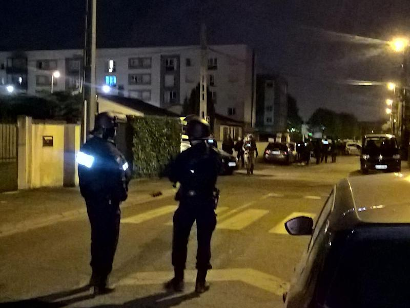 Police officers search the house of a suspect after a gunman opened fire on police in the Champs Elysees, in Chelles on 20 April (AFP/Getty Images)