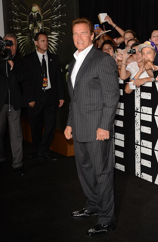 HOLLYWOOD, CA - AUGUST 15:  Actor Arnold Schwarzenegger arrives at Lionsgate Films' 'The Expendables 2' premiere on August 15, 2012 in Hollywood, California.  (Photo by Jason Merritt/Getty Images)