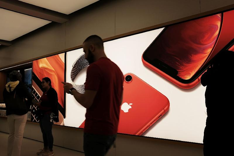 Apple became the world's most valuable company thanks to the iPhone, but its status is in jeopardy as a result of a slowing smartphone market (AFP Photo/SPENCER PLATT)