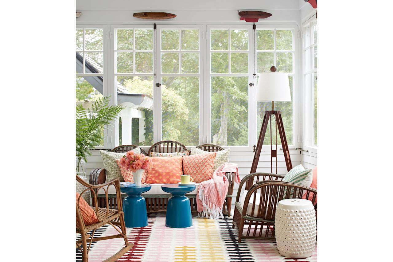 """<p>Rylee, along with builder Steve Murphy, went to work infusing the New England classic with fresh style and function for the young family. """"We preserved the historic details,"""" says Murphy, who kept the cottage's original flooring, windows, doors, and woodwork, blending architectural salvage and carefully reproduced millwork where needed.</p> <p>And while the team wanted the home to serve the present-day needs of a busy family, """"we didn't want it to feel slick and suburban,"""" Rylee says. Allowing the floors to remain uneven and quirky, she says, was one way to keep the home grounded in its history.</p> <p>Pictured: On the screened porch, vintage wicker furnishings evoke the past. Half-hull boat models—hung as a dimensional border near the ceiling—lend nautical New England charm.</p>"""