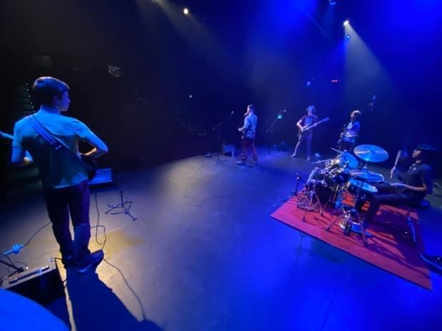 Yellowknife band Quantum Haze performs at the Northern Arts and Culture Centre. They put on an epic, socially-distant show this week.  (Chantal Dubuc/CBC - image credit)