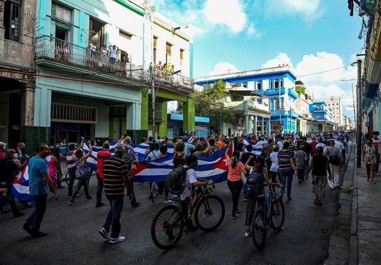 People take part in a demonstration to support the government after protests against President Miguel Diaz-Canel