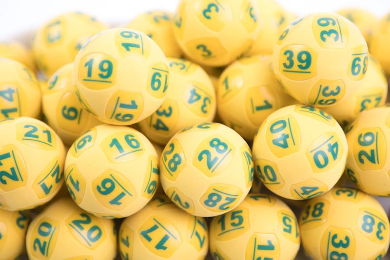OzLotto balls shown as officials wait on NSW and Victorian winners to come forward.