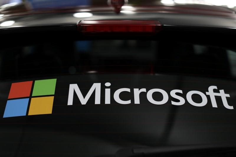 The Microsoft logo is shown on an electric car at the Auto Show in Los Angeles