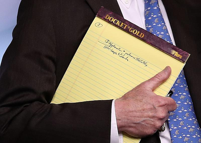 WASHINGTON, DC - JANUARY 28: With handwritten notes on a legal pad, National Security Advisor John Bolton listens to questions from reporters during a press briefing at the White House January 28, 2019 in Washington, DC. During the briefing, economic sanctions against Venezuela's state owned oil company were announced in an effort to force Venezuelan President Maduro to step down.