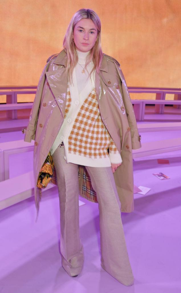 <p>Camille Charrière rocked a patent trench and flares at the Mulberry SS18 preview. <em>[Photo: Getty]</em> </p>