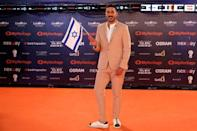"Contestant Kobi Marimi of Israel poses on the ""Orange Carpet"" during the opening ceremony of the 2019 Eurovision Song Contest in Tel Aviv, Israel May 12, 2019. REUTERS/Amir Cohen"