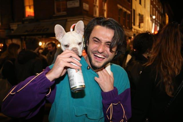 A man with a dog out in Soho, central London