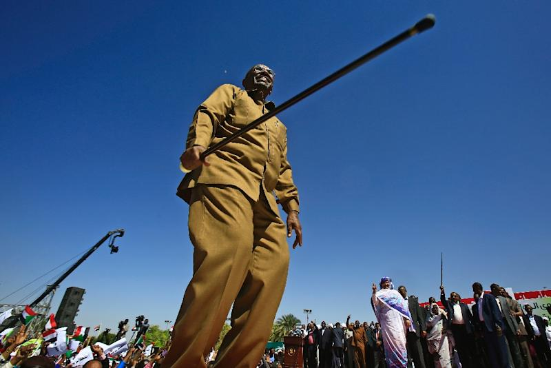 Sudan's Omar al-Bashir, seen here addressing supporters at a Khartoum rally before his ouster and detention by the army last week, ruled the country with an iron fist for three decades (AFP Photo/ASHRAF SHAZLY)