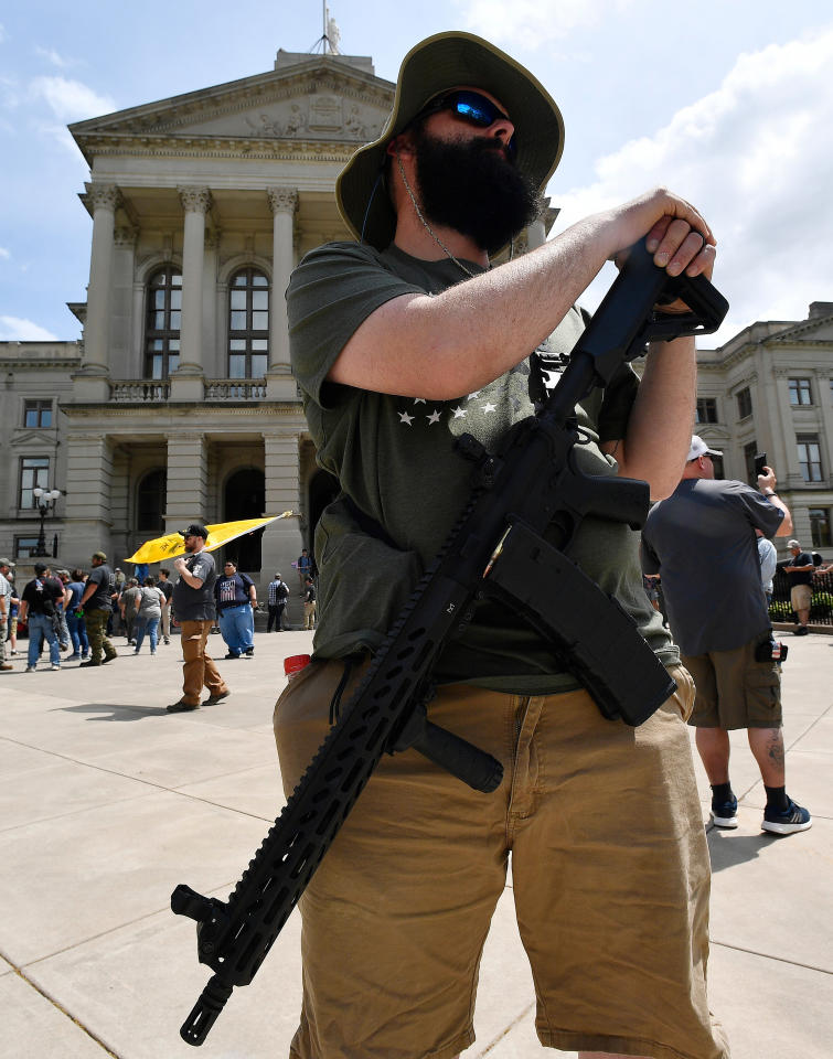 <p>Andrew Norris, of Monroe, Ga., participates in a gun-rights rally at the state capitol, Saturday, April 14, 2018, in Atlanta, Ga. About 40 gun rights supporters have gathered for one of dozens of rallies planned at statehouses across the U.S. (Photo: Mike Stewart/AP) </p>