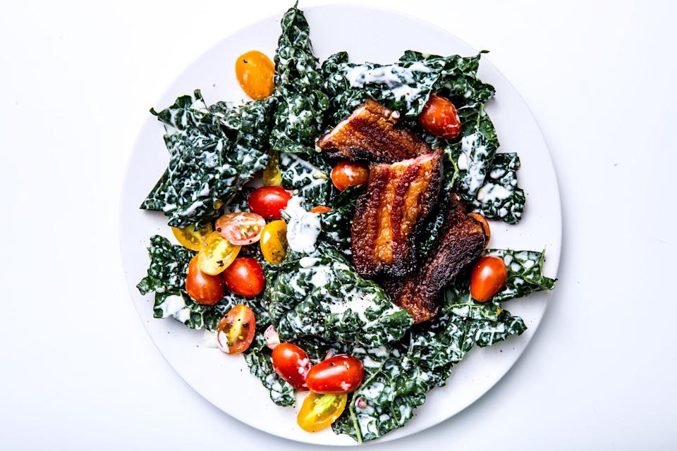 """Thick slab bacon is key to this dish. Buy it packaged if you can find it or from the butcher. <a href=""""https://www.bonappetit.com/recipe/kale-blt-salad?mbid=synd_yahoo_rss"""" rel=""""nofollow noopener"""" target=""""_blank"""" data-ylk=""""slk:See recipe."""" class=""""link rapid-noclick-resp"""">See recipe.</a>"""