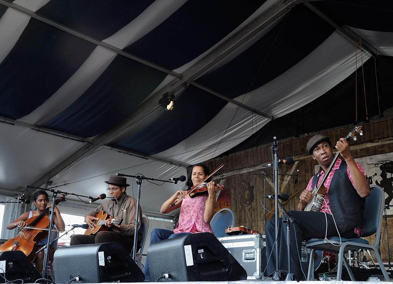 NEW ORLEANS, LA - APRIL 28:  Carolina Chocolate Drops performs during the 2012 New Orleans Jazz & Heritage Festival Day 2 at the Fair Grounds Race Course on April 28, 2012 in New Orleans, Louisiana.  (Photo by Rick Diamond/Getty Images)