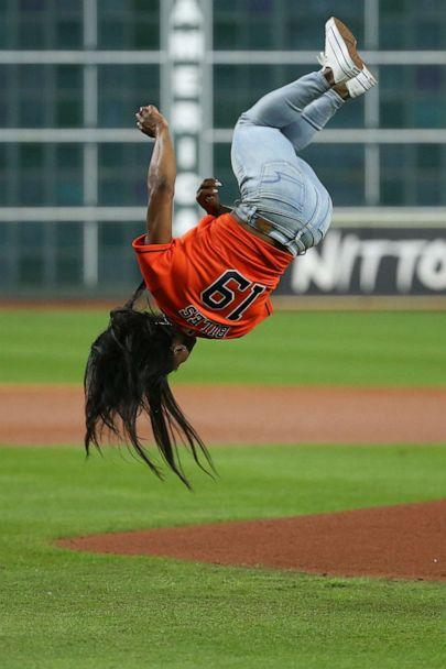 Olympic gymnastics gold medalist Simone Biles performs a flip before throwing out a ceremonial first pitch prior to game two of the 2019 World Series between the Houston Astros and the Washington Nationals at Minute Maid Park, Oct 23, 2019 in Houston. (Troy Taormina/USA TODAY Sports via Reuters)