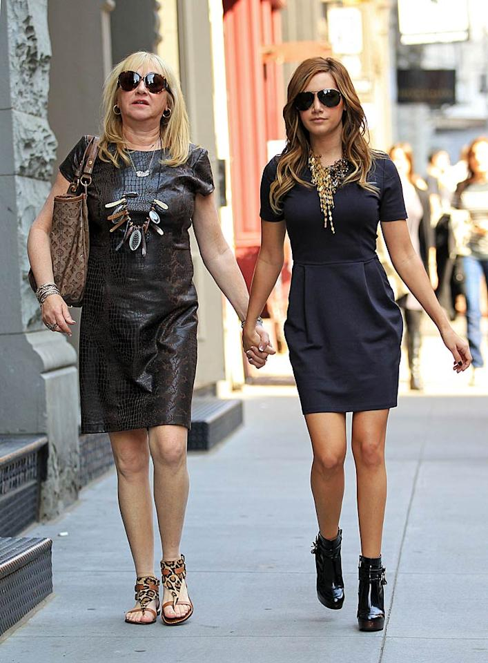 "Ashley Tisdale, star of the new ""High School Musical"" spin-off DVD ""Sharpay's Fabulous Adventure,"" and her mom Lisa shopped 'til they dropped on Monday in NYC. Aw, the 25-year-old even held hands with her mom! Jackson Lee/<a href=""http://www.splashnewsonline.com"" target=""new"">Splash News</a> - April 11, 2011"