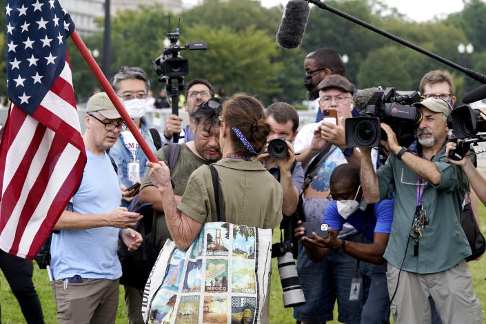 """Media gather to listen to a person talking as they attend a rally near the U.S. Capitol in Washington, Saturday, Sept. 18, 2021. The rally was planned by allies of former President Donald Trump and aimed at supporting the so-called """"political prisoners"""" of the Jan. 6 insurrection at the U.S. Capitol. (AP Photo/Alex Brandon)"""