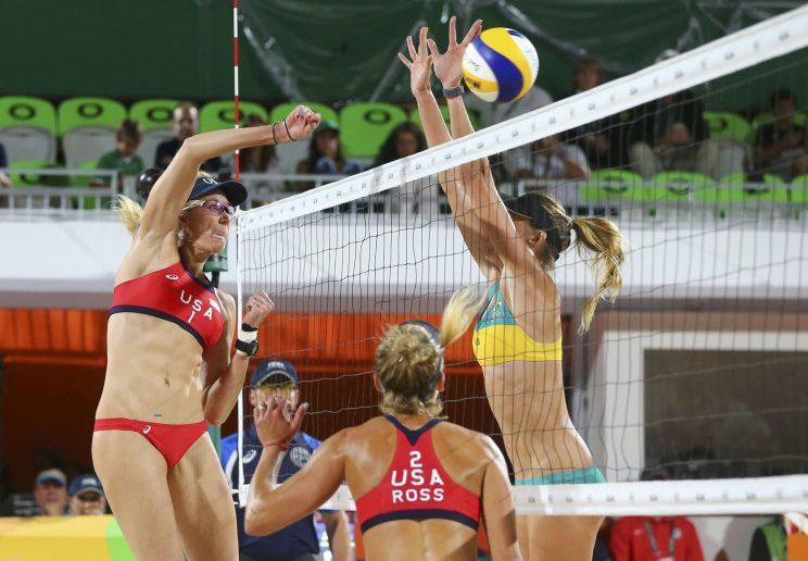 Kerri Walsh Jennings (USA) of USA and Mariafe Artacho (AUS) of Australia compete. REUTERS/Ruben Sprich
