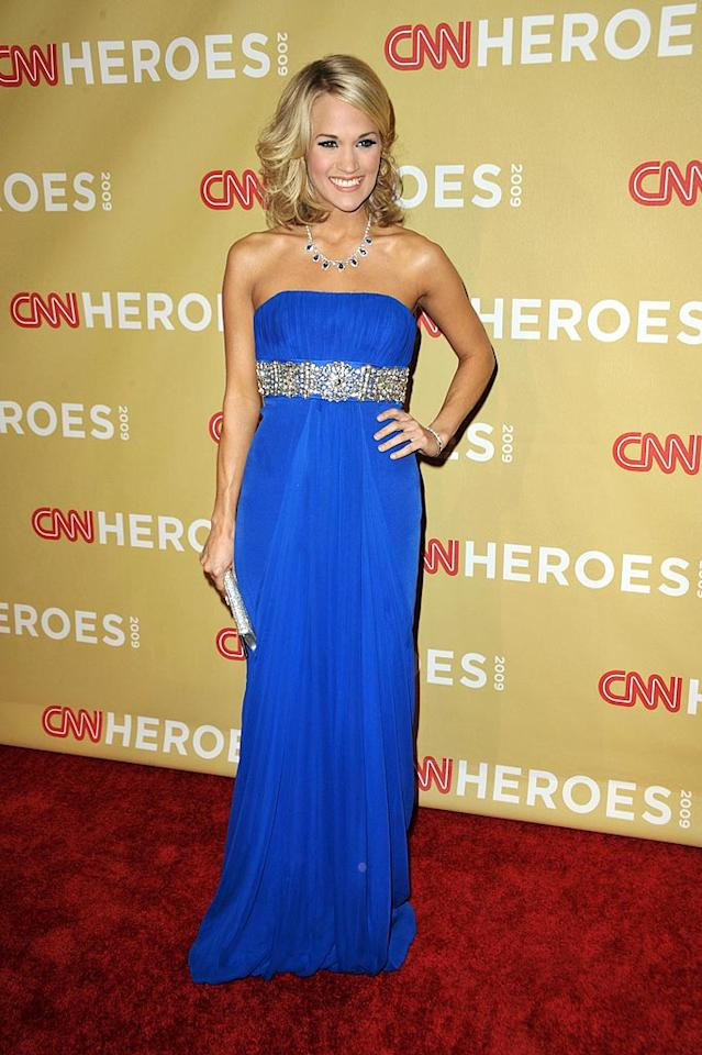 "The night before Carrie Underwood rocked the house at the American Music Awards, the country cutie debuted her refreshing new 'do while strutting down the red carpet at the CNN Heroes ceremony in a stunning cobalt blue strapless gown and a statement necklace. John Shearer/<a href=""http://www.wireimage.com"" target=""new"">WireImage.com</a> - November 21, 2009"